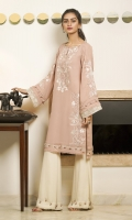 A baby pink malai-georgette kurta, finished with feminine embroideries and chic contrast-fabric details.