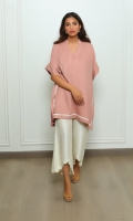 A trendy box-cut kurta in a taupe-pink colour, finished with delicate white embroidery and pintucks on the shoulder.