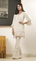 A white shawl-fabric kurta containing bright embroideries and feminine finishes.