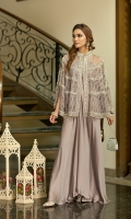 This outfit has a silk skirt with a beautifully embellished cape.