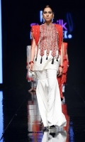 Lawn top with cross stitch neckline,with black thread tassels hanging. White cotton plain gharara paired with red cotton net gold zari dupatta.