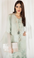 Mint paneled cotton net shirt tucked with organza patch at the border of the front panel has oversized organza sleeves with side and front slits paired with Pk raw silk pants.