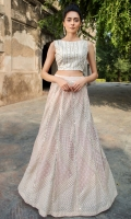 Stitched  peach colored blouse and lehenga is fully encrusted with detailed mirror, thread and zaree work  laid back on luxe fabric combined together  to stand out the whole look!.