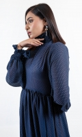 Dare to be bold in Raegan adorned with polka print in blue and white A style perfect for summer Raegan is cut from soft Georgette fabric with a Smoked neckline and  airy puff sleeves