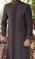 Sherwani stylized with jamawar fabric sleeves and front panel jamawar piping with the contrast of velvet patch work applied on front panel, sleeves and collar with rivets