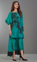 This regal emerald green shirt embellished in Swarovski Crystals on the front is beautifully highlighted with asymmetrical ruffled sleeves and finished with an embellished border on the back and sleeve.