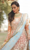 Peach formal organza shirt fully worked in gold. It is paired with a chooridar and blue contrasting tissue dupatta.