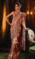 Our most coveted couture piece the Kohinoor saree is made from the finest pure banarsi tissue fabric and reflects luxury and panache. This saree is embellished with exquisite handmade 3D flowers, fine sequins, beads, Swarovski crystals and stones. Adorned with an intricate floral embroidered border on a beautiful Rosemist colour. This splendid saree is paired with a Jamawar blouse.  6.5 meters Pure Banarsi Tissue  1.5 meters Banarsi Jamawar Blouse