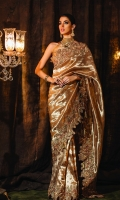 "Laleh: One of our finest pieces the ""Laleh"" bronze gold banarsi tissue saree set exudes impeccable workmanship. This saree is crafted with the finest touch of our signature embroidery, intricately embellished with mesmerizing 3D flowers encrusted with Swarovski crystals, beads and sequence. The saree is paired with Banarsi Jamawar blouse.  6.5 meters Pure Banarsi Tissue 1.5 meters Banarsi Jamawar Blouse"